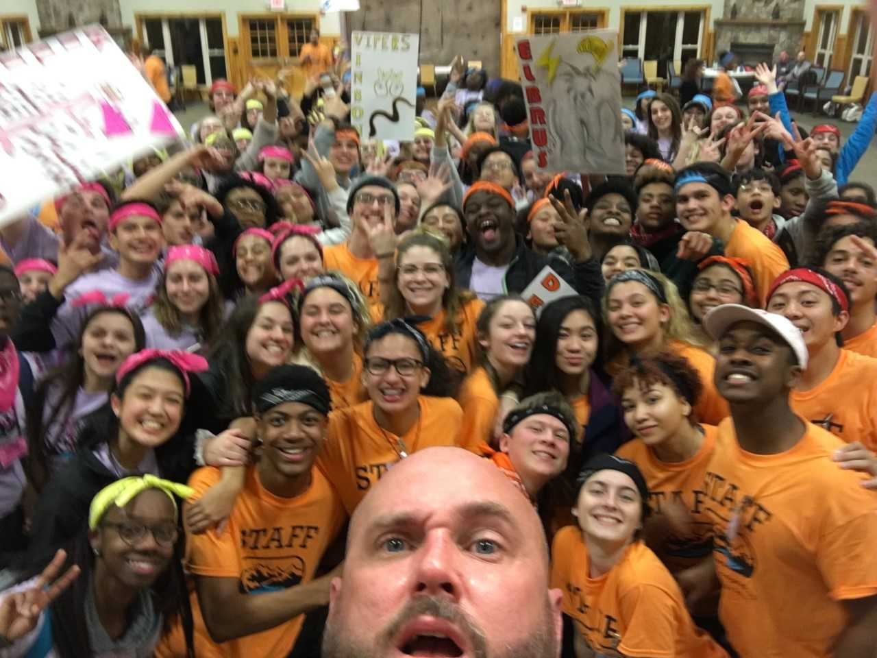 Mr. Lawler takes a selfie with students during Leadership Workshop.