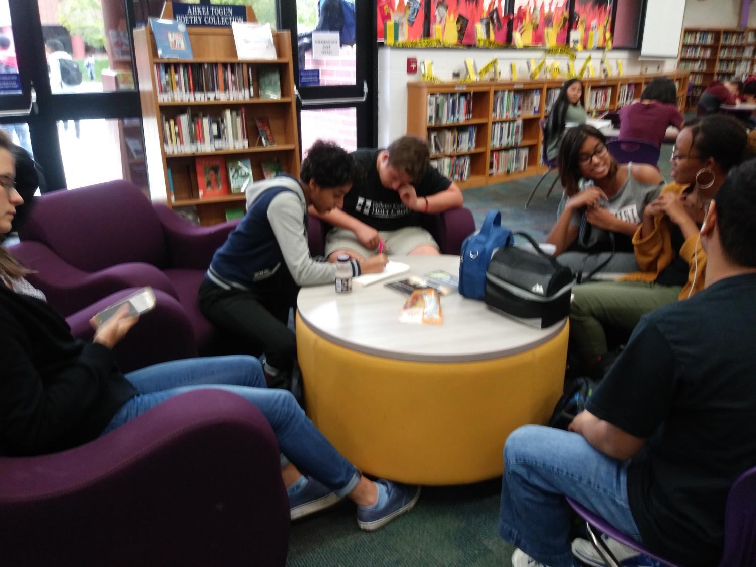Students studying and hanging out in the library during Lion Lunch