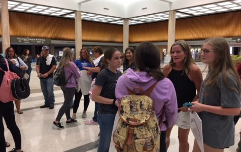 Tallwood GSWLA students greet visitors from Northern Ireland at the Norfolk International Airport.
