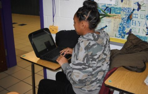 Jelian Swan working on her photography section of the Literary Magazine.