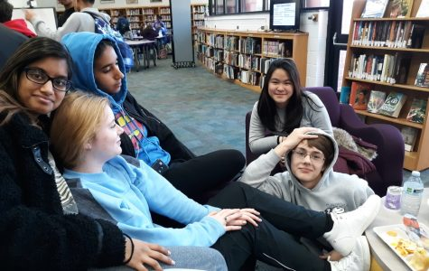 Students in the LMC wear their hoodies as they discuss their thoughts on the new hoodie policy.